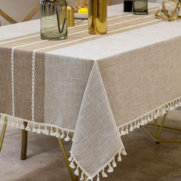 brown and tan indoor/outdoor table cover with tassels