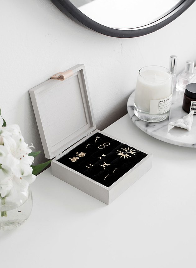 white jewelry organizer idea with black velvet interior