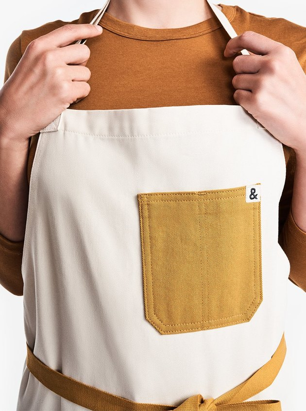 person wearing apron with yellow pocket