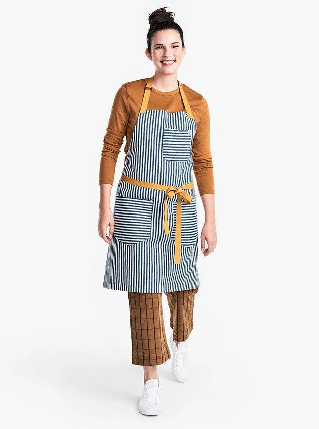 person wearing striped apron