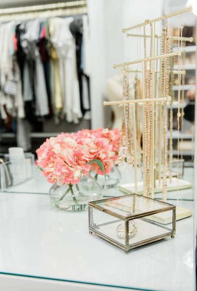 jewelry organizer idea with gold necklace stand