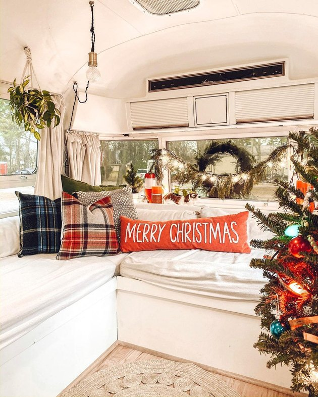 van with couch and holiday-themed pillows