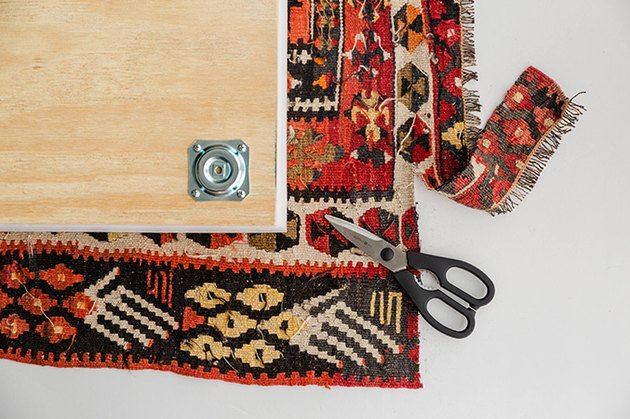 Cut the vintage rug to size.