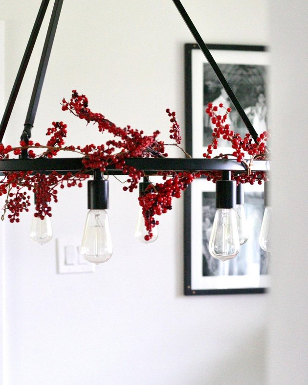 lighting fixture with holly berries.