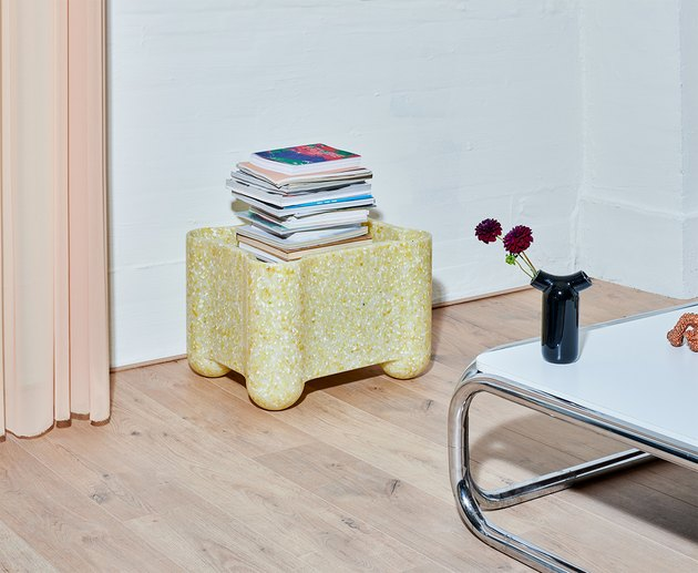 yellow crate with books in living room area