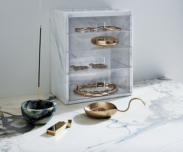 Earring Storage with Marble jewelry organizer with clear drawers, brass bowl, marble incense burner.