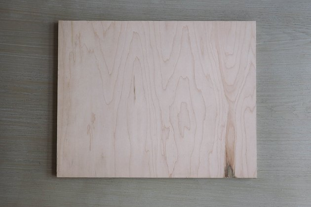 Plywood board cut to size of tray
