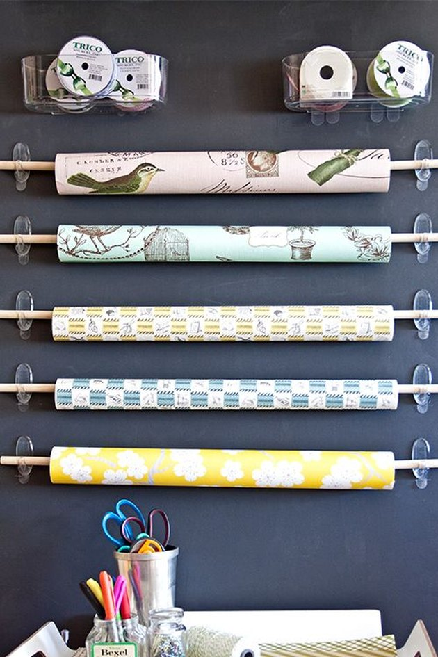 wrapping paper storage on chalkboard wall with command hooks
