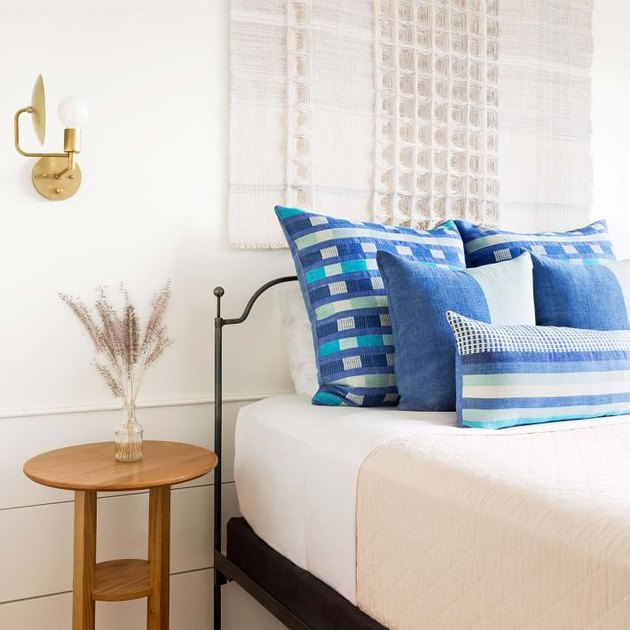 West Elm Local blue accent pillows on bed