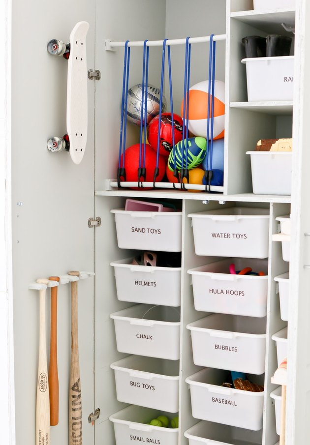 DIY garage organization idea with cabinet with labeled bins