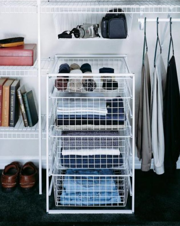 Closet organizer with white wire drawer unit, clothes, shoes.
