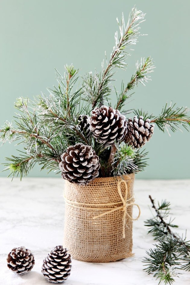 pine cone in vase made out of a can for a centerpiece decoration