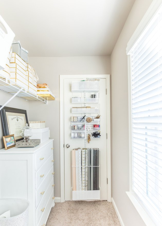 craft room with wrapping papper storage idea on back door