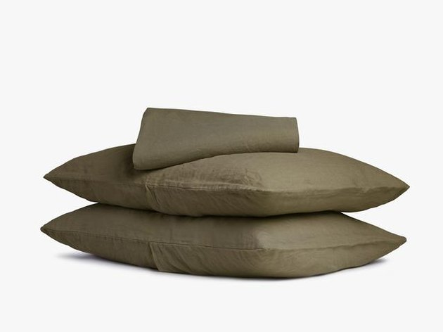 stacked olive pillowcases and sheet