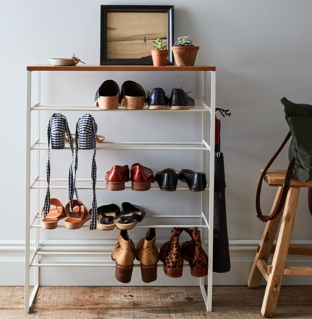 Closet Organizer with Metal and wood shoe rack, shoes, plants, photo.