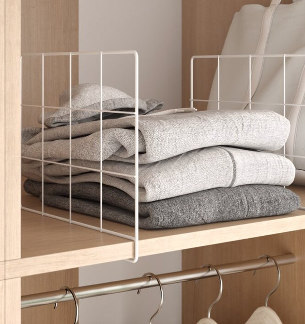 Closet Organizer with Sweaters on shelf with shelf divider.