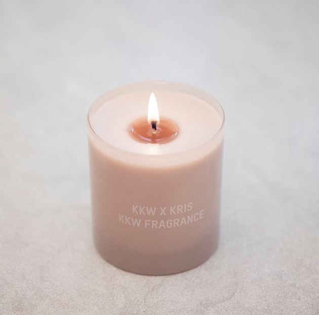 kkw x kris candle burning on a beige table