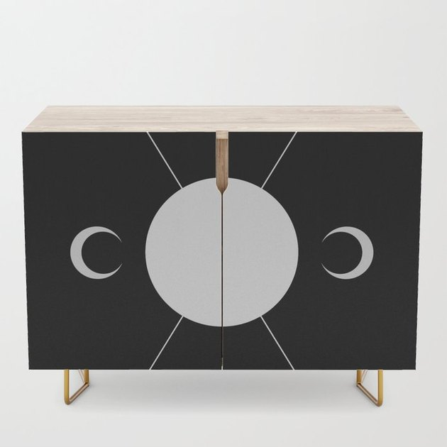 moon-inspired Credenza in black and birch with steel legs