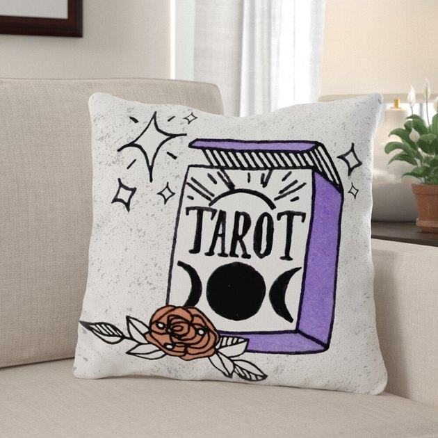 Illustrated Tarot Magic Throw Pillow on couch