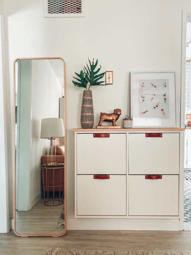 IKEA built-in entryway shoe storage with drawers and decorative tabletop pieces
