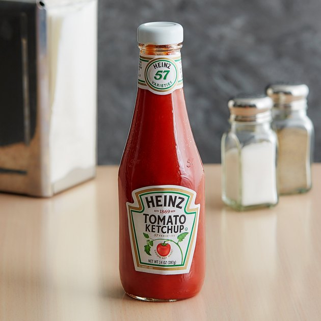 Heinz 14 oz. Ketchup glass bottle on countertop with salt and pepper