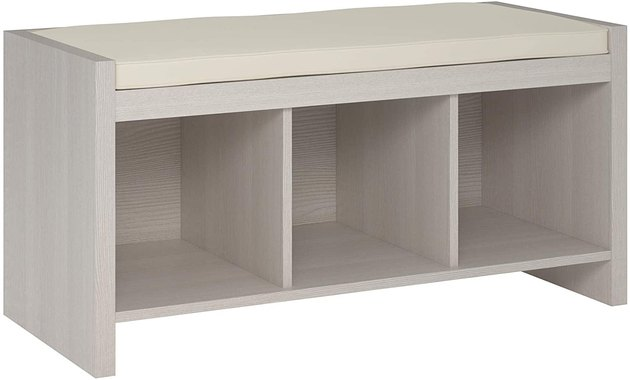 gray bedroom storage bench with cushioned top and cubbies