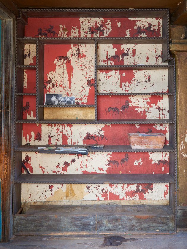 old red wallpaper behind furniture