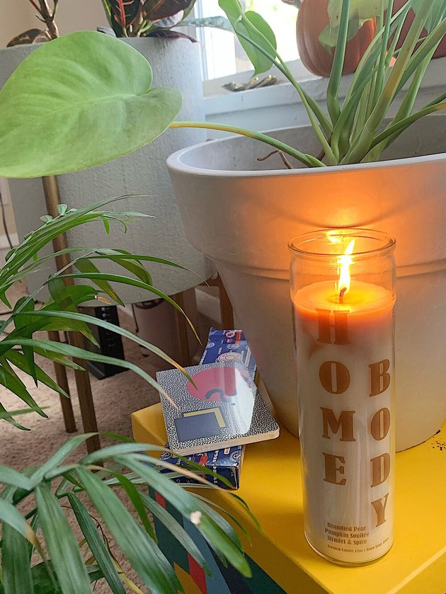 candle near table and plants