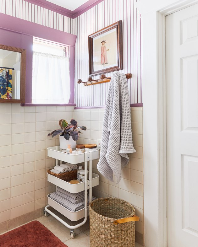 Modern bathroom storage with an IKEA utility cart designed by Emily Henderson