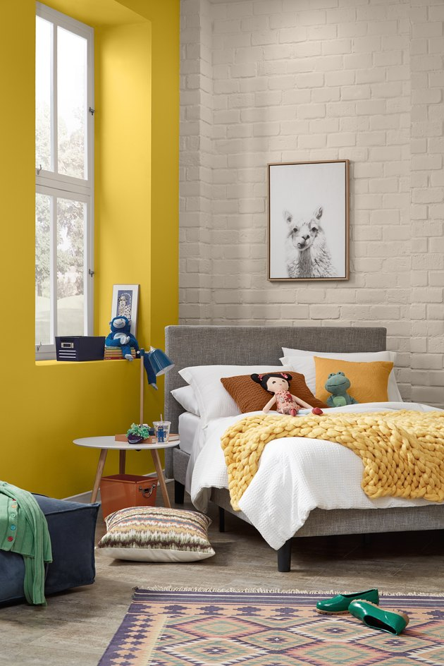 kids room with yellow wall and patterned rug