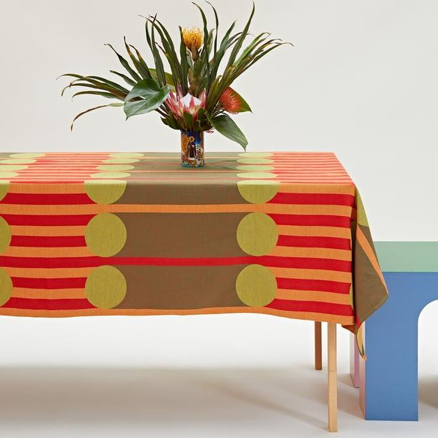 table with plant and colorful, patterned tablecloth