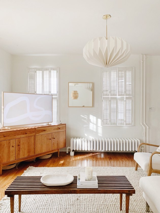 Sylvia Tribel  living room with pendant light and area rug