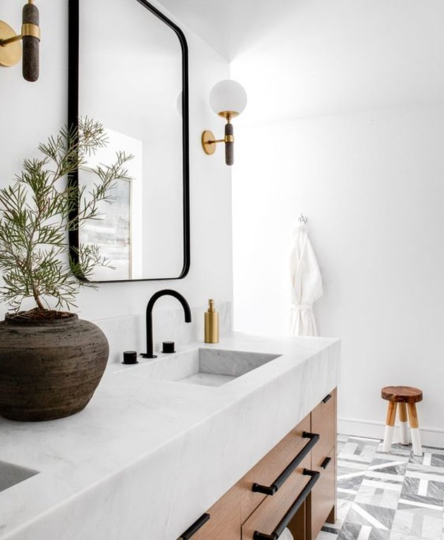 modern boho bathroom with marble counter and marble bathroom sink