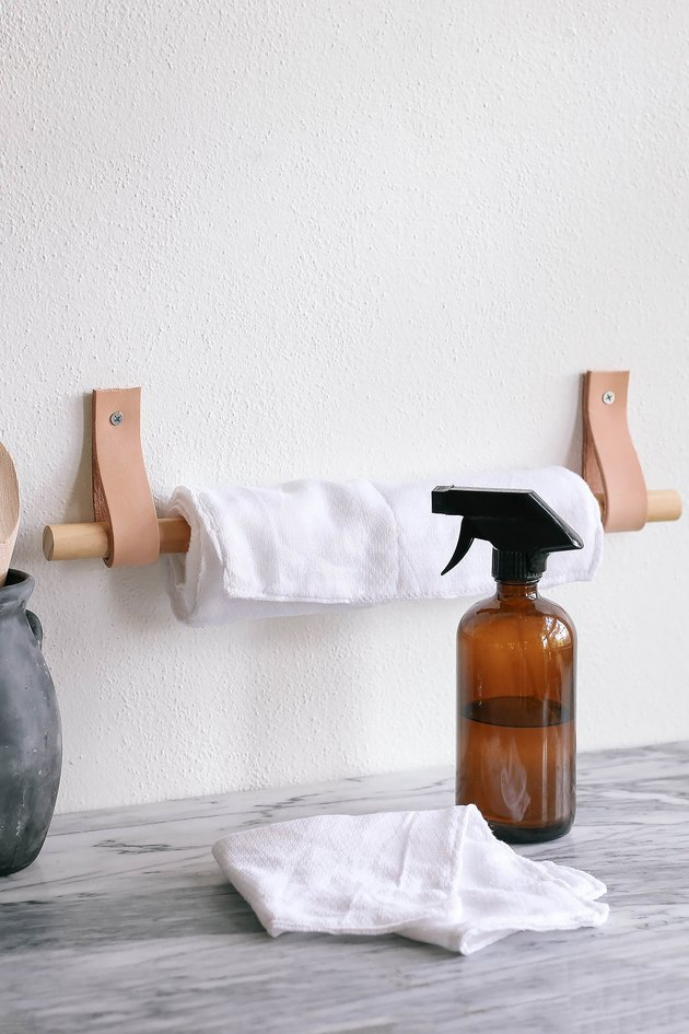 DIY unpaper towels hanging on wood and leather paper towel holder