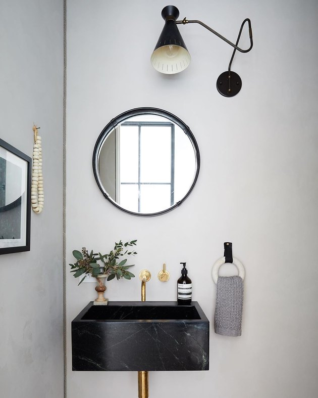 black and white modern bathroom with marble bathroom sink
