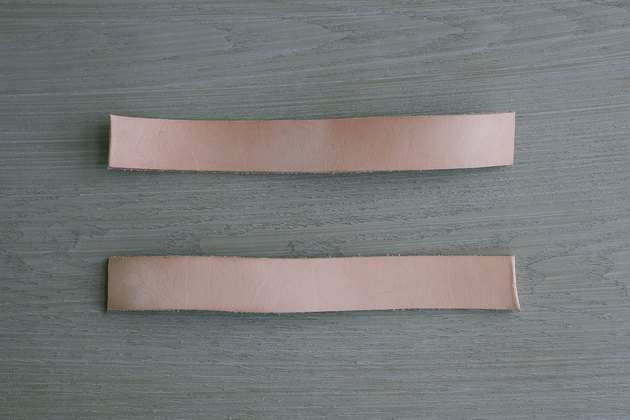 Two leather strips cut to 9-inch lengths