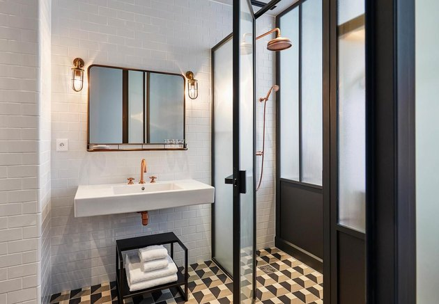 white hotel bathroom with frosted glass shower door