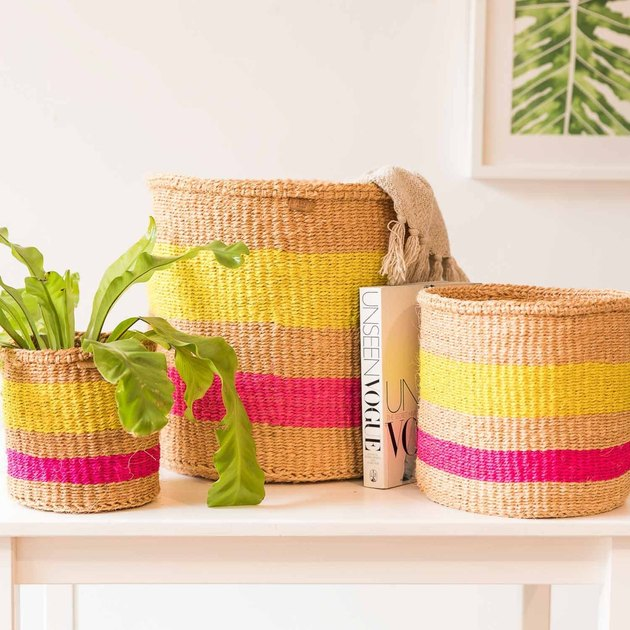 The Basket Room Mazao Woven Storage Basket on table with book and plant