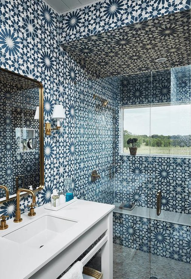 blue and white moroccan tiled bathroom and bohemian shower