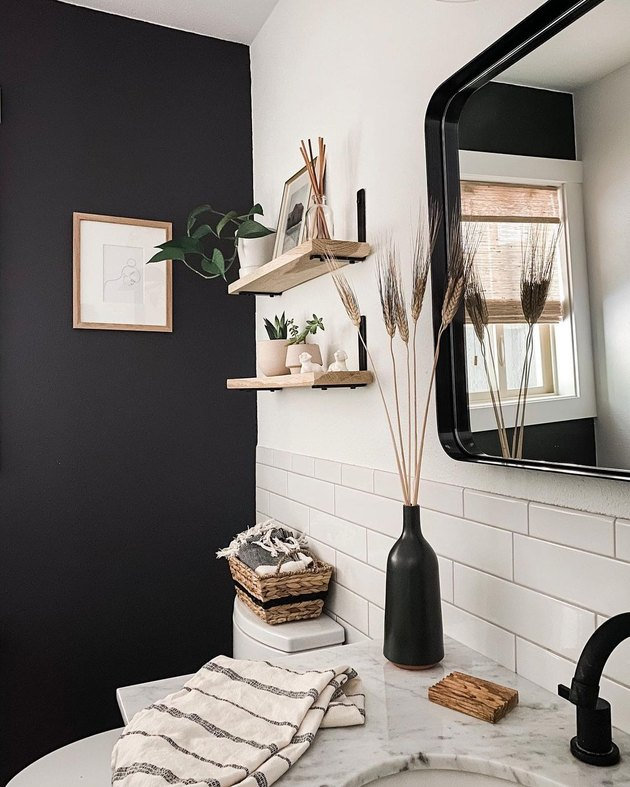 small modern bathroom with black accent wall