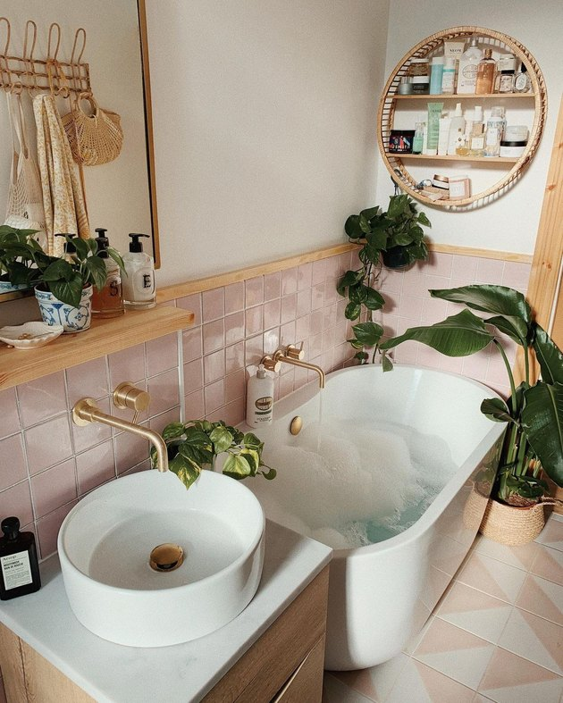 pink small modern bathroom with freestanding tub