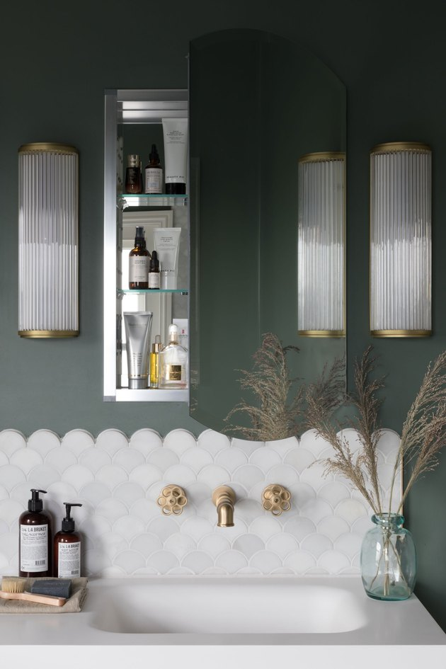 Brass Bathroom Faucet in green bathroom with scallop tiles and vintage style brass faucet