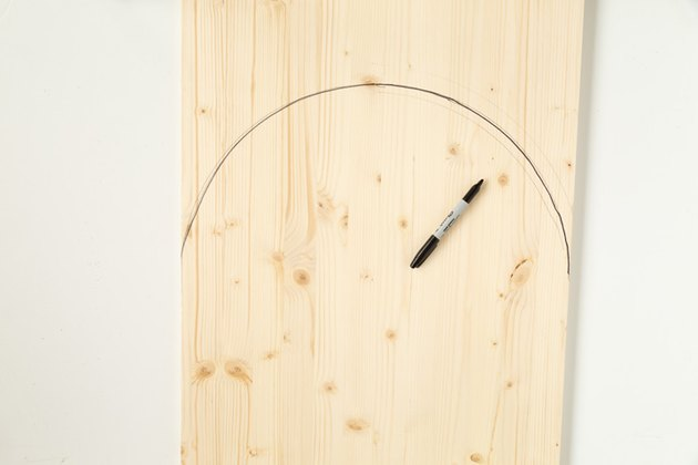 Marking an arch shape with marker on wood board