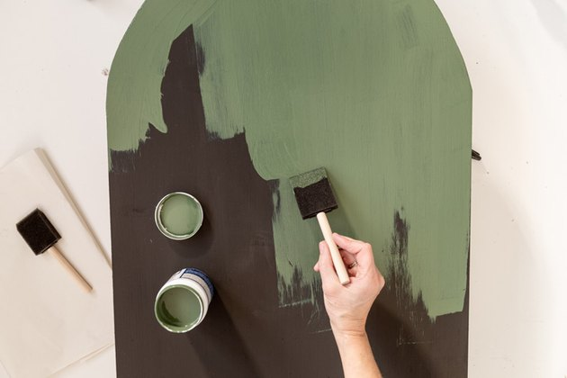 Painting green paint over magnetic board