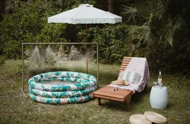 Outdoor mister over blow up pool and lounge chair
