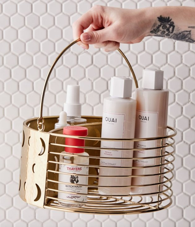 Brass best shower caddies, shampoos, soaps, hexagon tile.