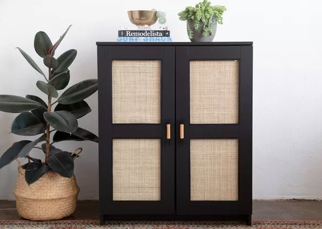 Black and cane IKEA cabinet