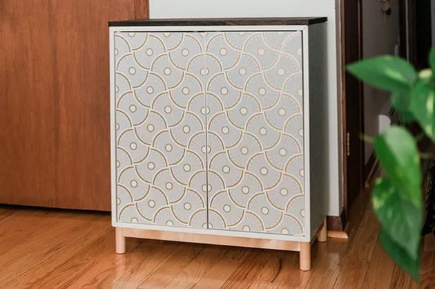 Cabinet with modern wallpaper.