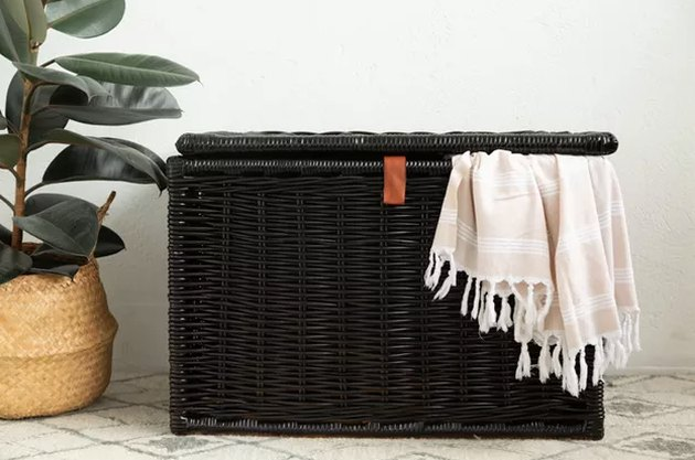 Black painted wicker trunk/chest with blanket