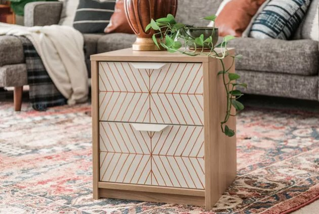 Painted side table with geometric design